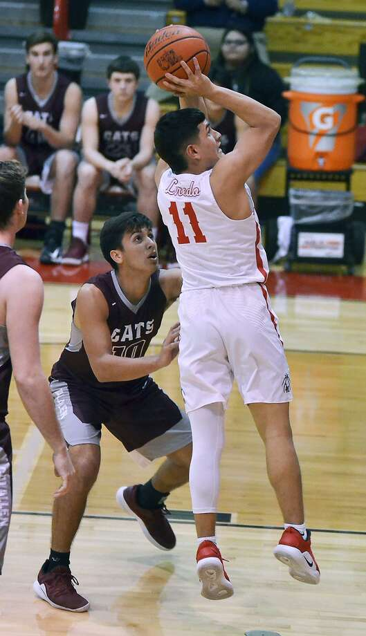 Carlos Cortinas totaled 7 points in Martin's win over Calallen Tuesday. Photo: Cuate Santos /Laredo Morning Times / Laredo Morning Times