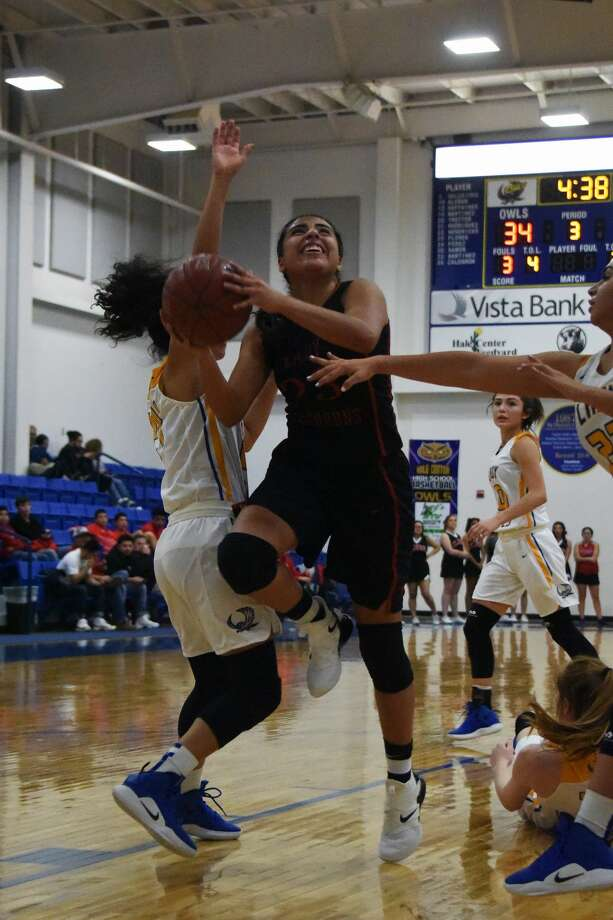 The Lockney Lady Longhorns used overtime to beat the Hale Center Lady Owls, 66-63, during District 4-2A action on Tuesday in Hale Center. Photo: Claudia Lusk/Plainview Herald