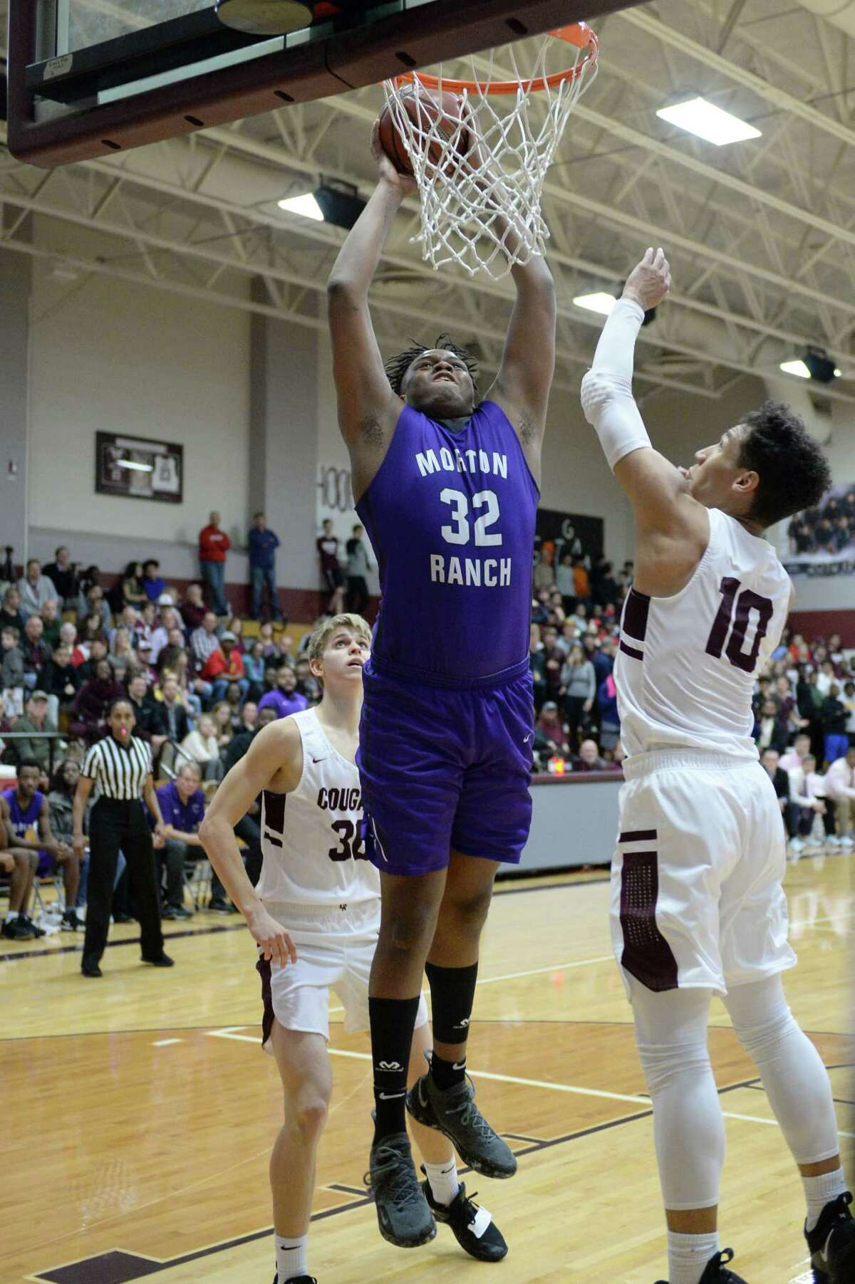 Eddie Lampkin (32) of Morton Ranch attempts a slam-dunk during the second half of a high school basketball game between the Cinco Ranch Cougars and the Morton Ranch Mavericks on Tuesday January 29, 2019 at Cinco Ranch HS, Katy, TX.