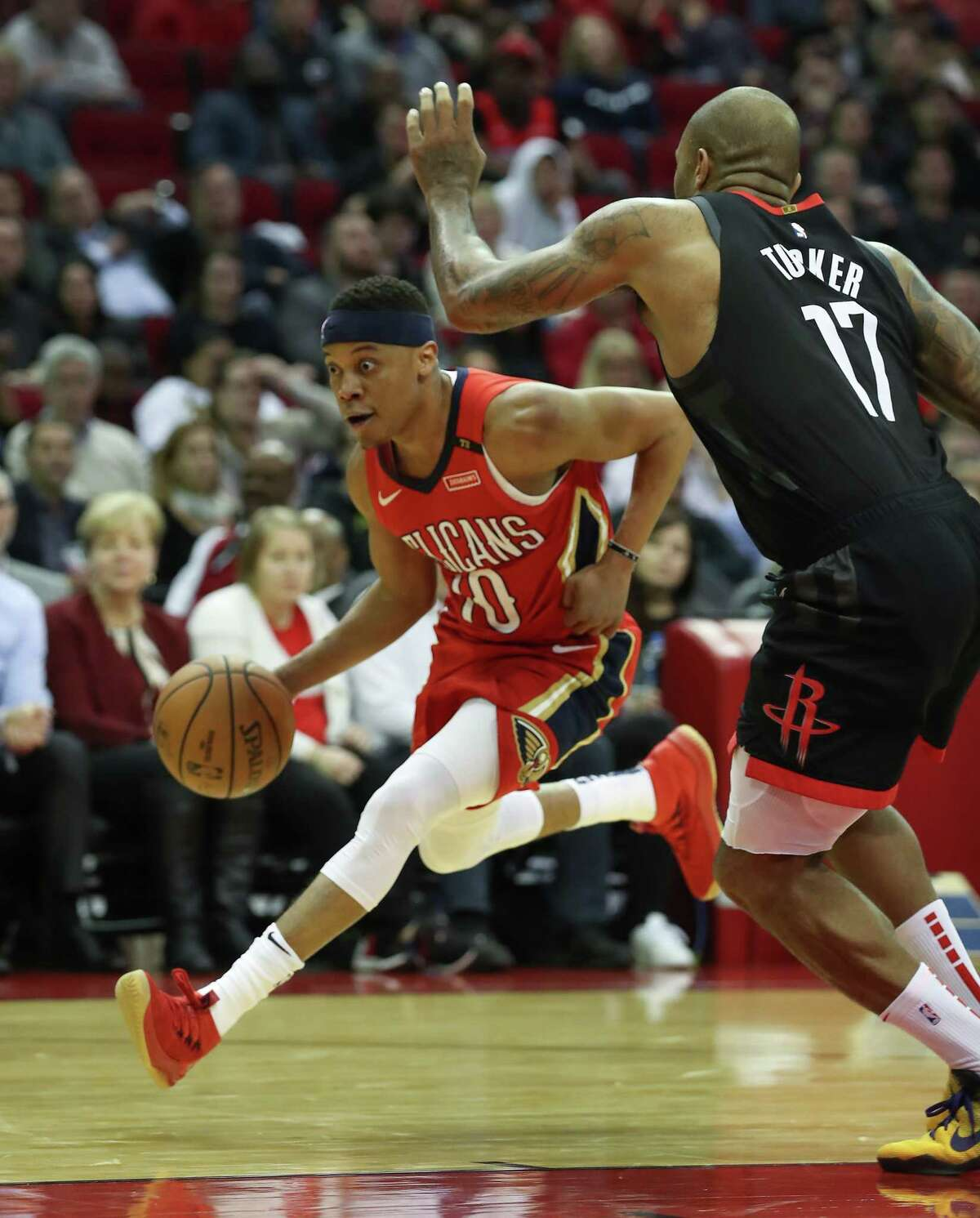 New Orleans Pelicans guard Tim Frazier (10) drives around Houston Rockets forward PJ Tucker (17) during the 2nd half of an NBA basketball game at Toyota Center on Tuesday, Jan. 29, 2019, in Houston.