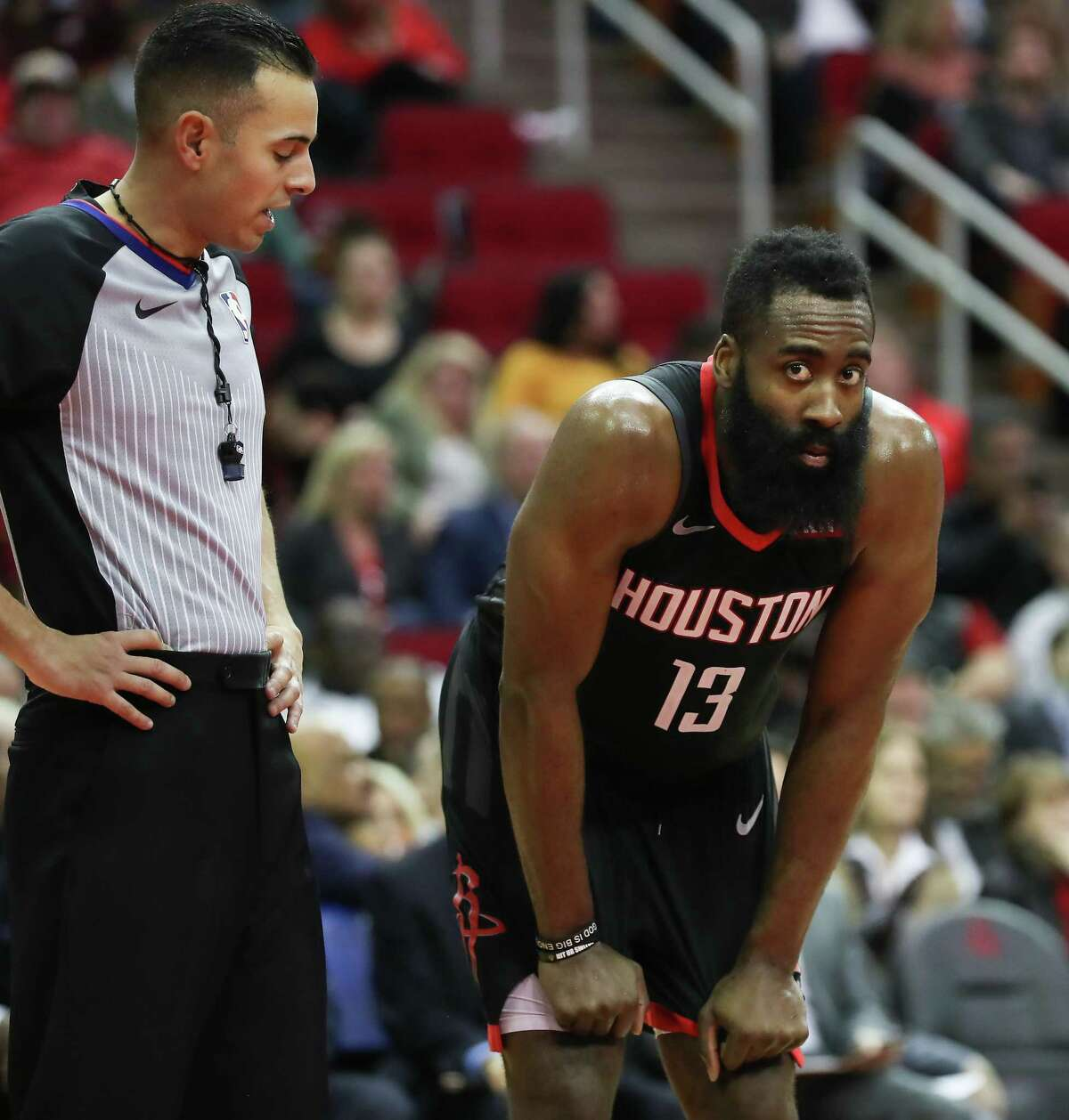 Referee Ray Acosta attempts to talk to Houston Rockets guard James Harden (13) during the 2nd half of an NBA basketball game at Toyota Center on Tuesday, Jan. 29, 2019, in Houston.