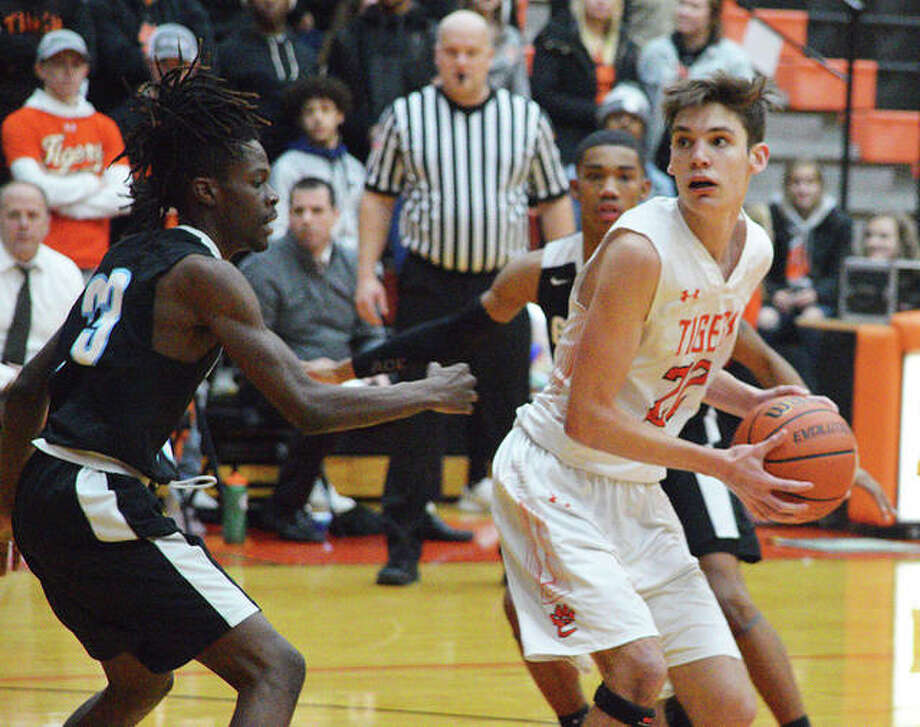 Edwardsville sophomore Brennan Weller, right, tries to get past a Gateway STEM defender during Tuesday's game at Lucco-Jackson Gymnasium. Photo: Scott Marion/Intelligencer
