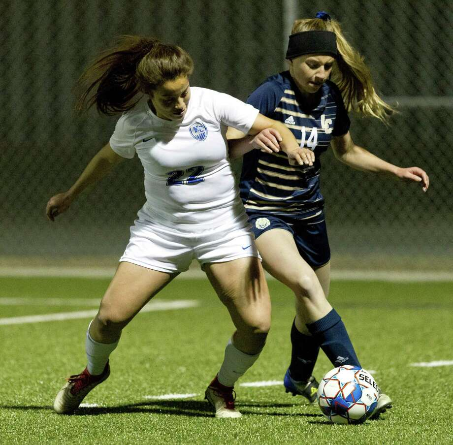 New Caney midfielder Emily Serrato (22) battles Lake Creek defender Brooklyn Ford (14) for the ball during the first period of a District 20-5A high school soccer match at Lake Creek High School, Tuesday, Jan 29, 2019, in Montgomery. Photo: Jason Fochtman, Houston Chronicle / Staff Photographer / © 2019 Houston Chronicle