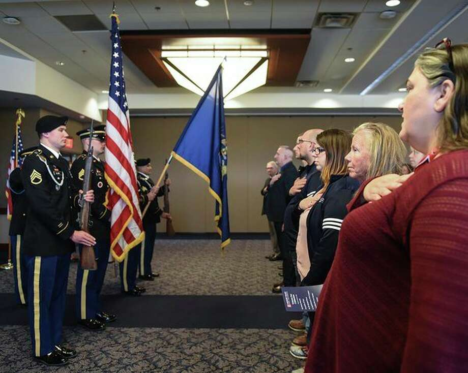 A military color guard presents the U.S. and Michigan flags during a Veterans Day ceremony at Saginaw Valley State University on Nov. 8, 2018. (Photo provided/Tim Inman, SVSU)