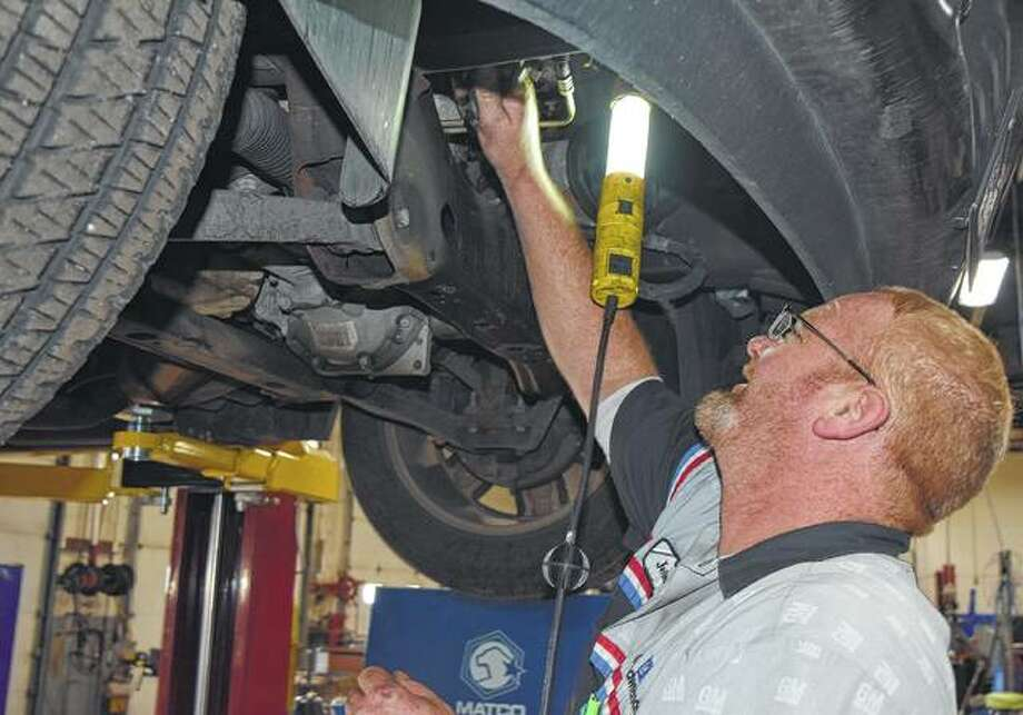 Jeremiah DeWitt works on a car Tuesday at Green Chevrolet Buick GMC. Photo: Samantha McDaniel-Ogletree | Journal-Courier