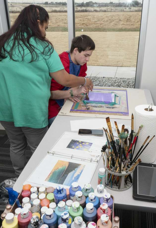 Ally Gamboa, one of only two mneme therapists in Texas, works on art with Andrew, a student at Bynum School. Click through to see photos of theBynum School Photo: Tim Fischer/Midland Reporter-Telegram