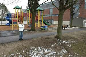 Dawn Fortunato, Vice-Chair District 3 RTM, shoots video of the field at Hamilton Avenue School. Fortunato and others from the area would like to see improvements to the schools field, they feel it is in poor condition. Friday, January 19, 2019, in Greenwich, Conn.