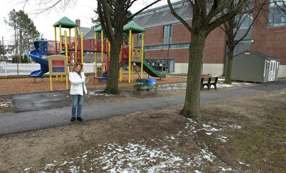 Dawn Fortunato, Vice-Chair District 3 RTM, shoots video of the field at Hamilton Avenue School. Fortunato and others from the area would like to see improvements to the schools field, they feel it is in poor condition. Friday, January 19, 2019, in Greenwich, Conn. Lucia Jansen, chair of the Representative Town Meeting's Budget Overview Committee, said there was a breakdown in the decision-making process over the project because the school administration did not give proper and complete information to the Board of Education, BET and RTM. Photo: H John Voorhees III / Hearst Connecticut Media / The News-Times