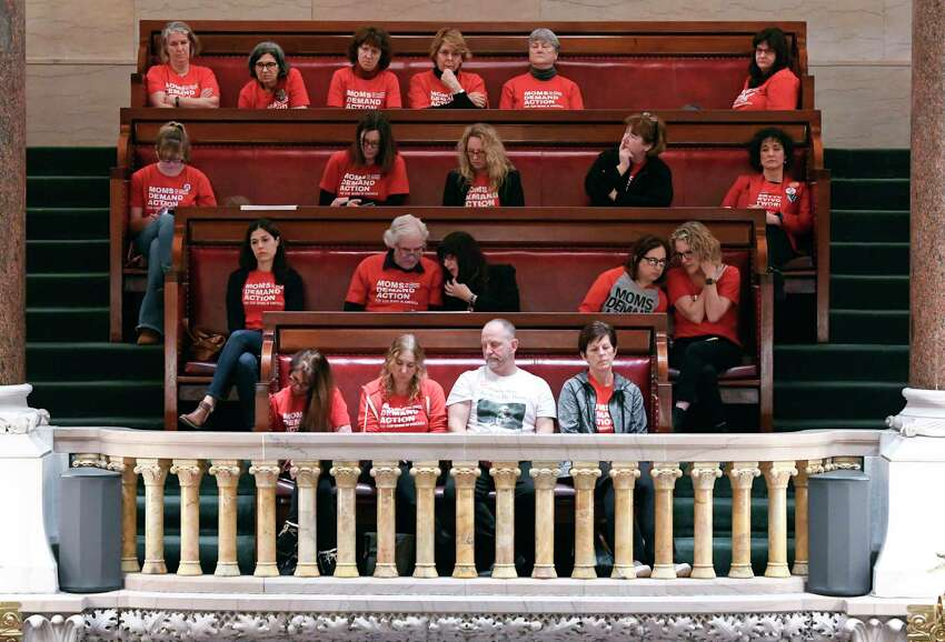Spectators from the group Moms Demand Action watch as Senators debate new legislation reforms to protect New Yorkers from gun violence in the Senate Chamber at the state Capitol on Tuesday, Jan. 29, 2019, in Albany, N.Y.