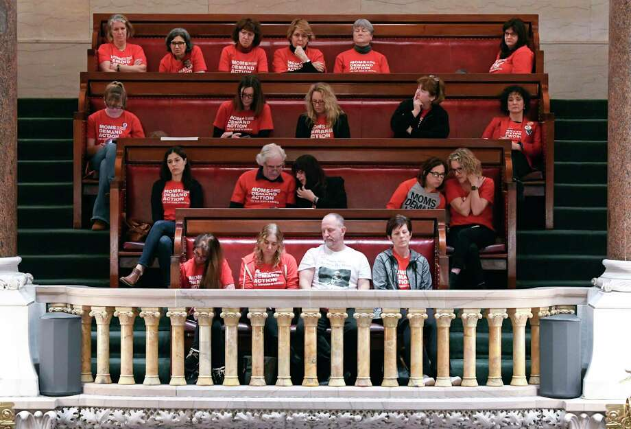 Spectators from the group Moms Demand Action watch as Senators debate new legislation reforms to protect New Yorkers from gun violence in the Senate Chamber at the state Capitol on Tuesday, Jan. 29, 2019, in Albany, N.Y. Photo: Hans Pennink, AP / FR58980 AP