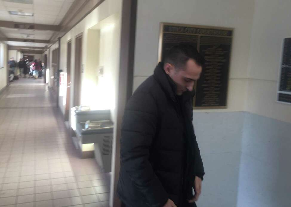 Albany police officer Christofer M. Kitto leaves Utica City Court Wednesday after he was arraigned on a misdemeanor prostitution charge. Kitto was allegedly with a prostitute in Utica when he shot and killed a man who tried to rob him on Jan. 7.