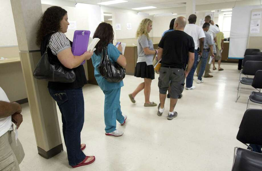 Texans who need renew or replace their driver's licenses or identification cards can continue to do so on Saturdays through the end of the year. Photo: Brett Coomer /Chronicle / Houston Chronicle