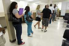 Customers wait in line at the Texas Department of Public Safety driver's license issuing office Thursday, Sept. 16, 2010, in Houston. ( Brett Coomer / Houston Chronicle )