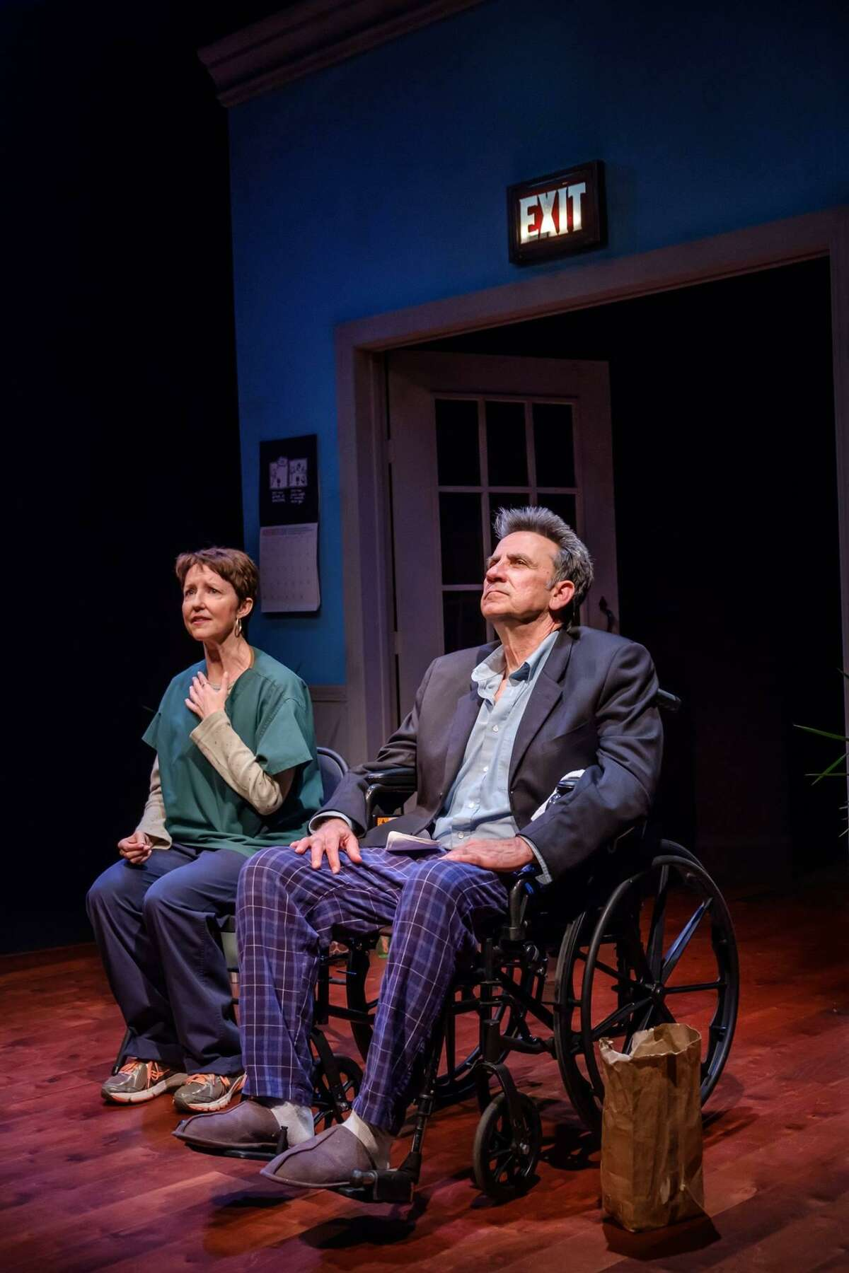 """Rebecca Robinson and Ken Webster star in """"Wakey, Wakey."""""""