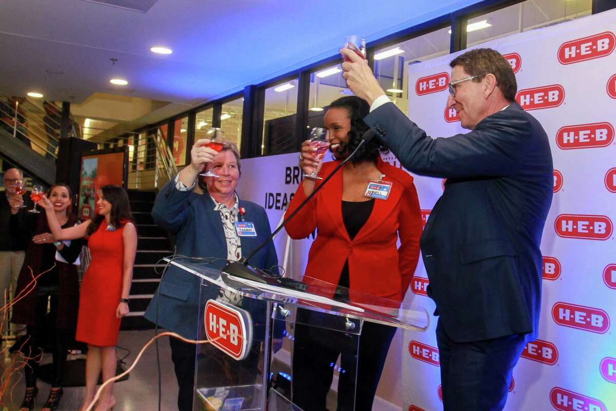 Tammy Hager, from left, Winell Herron and Scott McClelland of H-E-B toasting the new Heights H-E-B's grand opening at 2300 N. Shepherd Drive. Scott is President, H-E-B Food and Drug, Winell is Vice President of Public Affairs, Diversity and Environmental Affairs, and Tammy is the Heights Store Leader.