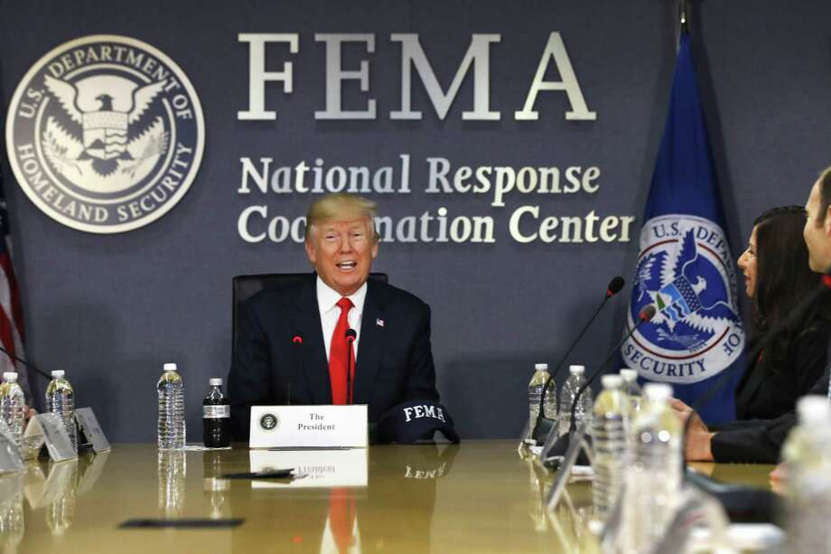 FILE - In this Aug. 4, 2017 file photo, President Donald Trump speaks at Federal Emergency Management Agency (FEMA) headquarters in Washington. The federal government has, for now, enough disaster aid money to deal with the immediate aftermath of Hurricane Harvey, but the ongoing storm appears sure to require a multibillion-dollar recovery package as did Hurricane Katrina and Superstorm Sandy. (AP Photo/Jacquelyn Martin, File) Photo: Jacquelyn Martin, STF / Associated Press / Copyright 2017 The Associated Press. All rights reserved.