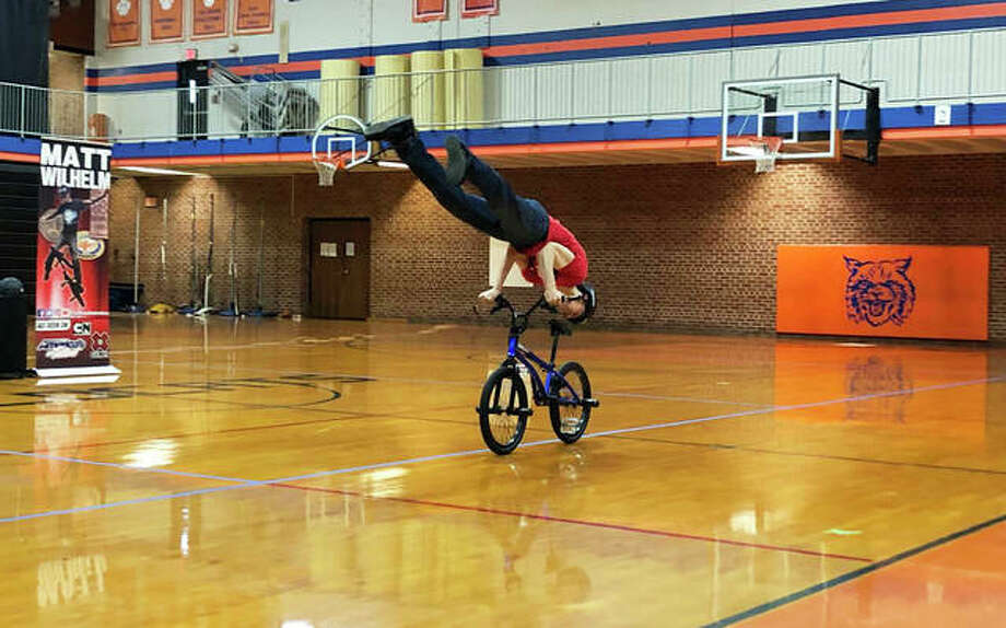 Matt Wilhelm, a three-time X Games medalist, performs tricks for Lincoln Middle School students before speaking to them about his experiences being bullied and how to combat the behavior. Photo: Julia Biggs | The Intelligencer