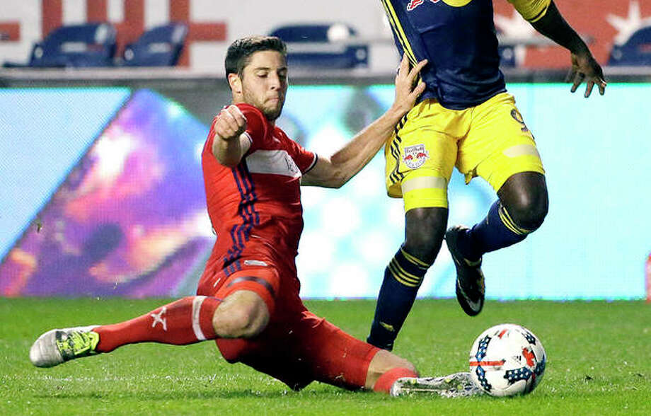 Former Chicago Fire and SIUE standout Matt Polster, left, goes for the ball against the New York Red Bulls during the second half of a 2017 MLS soccer playoff game, in Chicago. A defender, Polster has joined Scottish Premiership club Rangers after leaving the Fire of Major League Soccer.