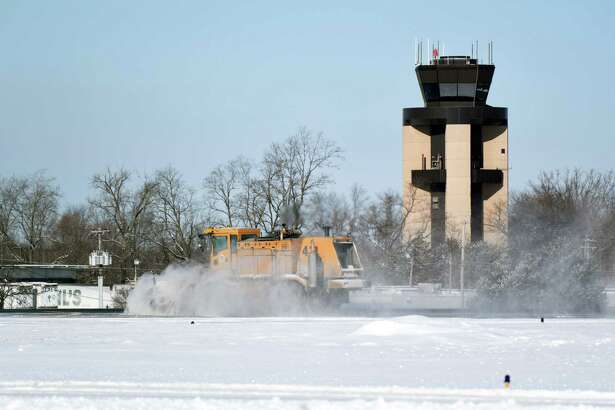 Snow plows clear snow at Albany International Airport on Wednesday, Jan. 30, 2019 in Latham, NY. ORG XMIT: 40046065A