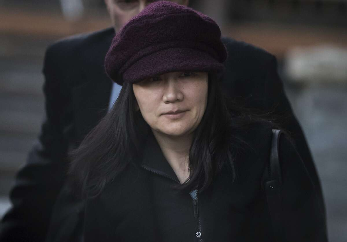 Huawei chief financial officer Meng Wanzhou leaves her home to attend a court appearance regarding her bail conditions, in Vancouver, British Columbia, Canada on Tuesday, Jan. 29, 2019. A Vancouver court heard that the United States has issued a formal extradition request for Meng, who was arrested Dec. 1, 2018 at Vancouver's airport at the request of U-S authorities. (Darryl Dyck/The Canadian Press via AP)