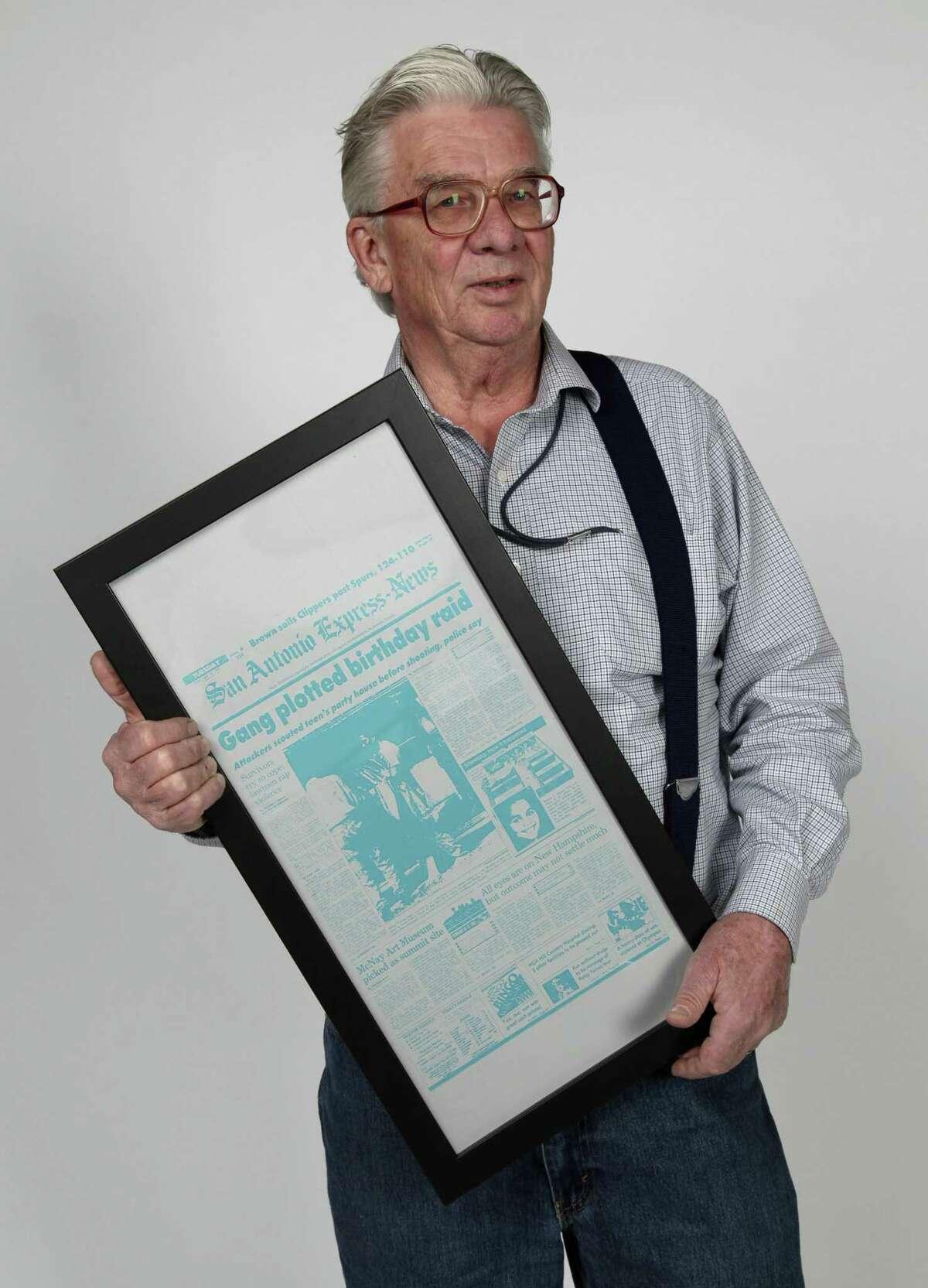 San Antonio Express-News Staff Writer John MacCormack in 2018, receiving a bit of newspaper memorabilia.