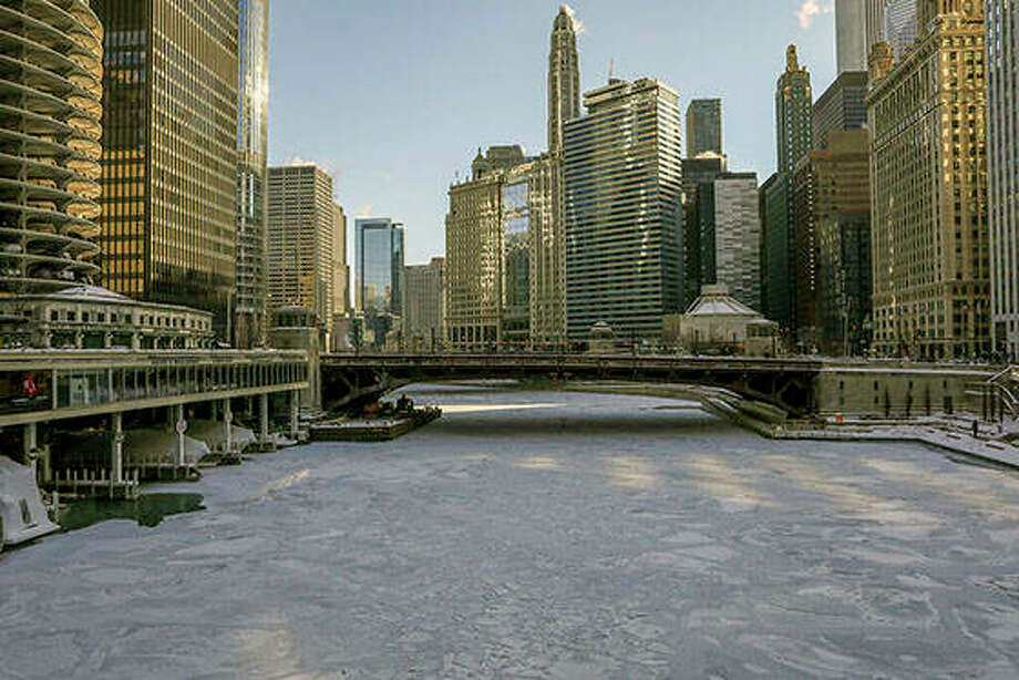 Ice covers the Chicago River Wednesday, Jan. 30, 2019, in Chicago. A deadly arctic deep freeze enveloped the Midwest with record-breaking temperatures triggering widespread closures of schools and businesses. (AP Photo/Teresa Crawford)