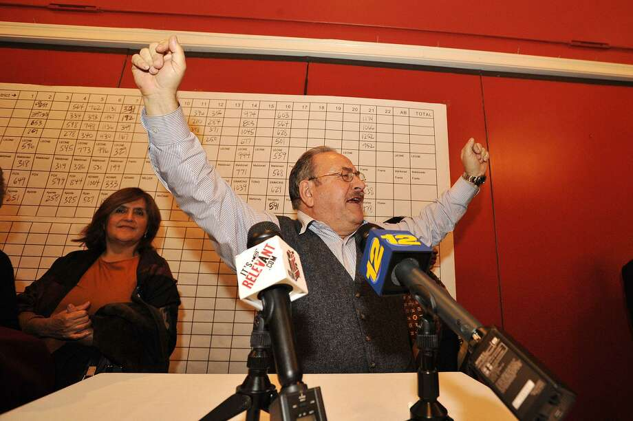 Stamford Democratic Party Chairman John Mallozzi throws his arms in the air while addressing supporters during the Democrat Party election night celebration at Zody's 19th Hole at E. Gaynor Brennan Golf Course in Stamford, Conn., on Nov. 4, 2014. Photo: Jason Rearick / Jason Rearick / Stamford Advocate
