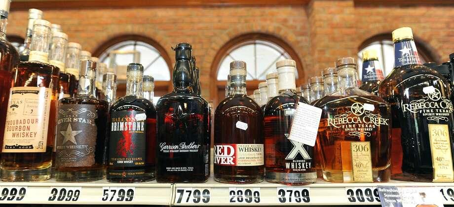 Texas whiskey at Debb's Liquor in Beaumont. Photo taken Wednesday, February 20, 2013 Guiseppe Barranco/The Enterprise Photo: Guiseppe Barranco, STAFF PHOTOGRAPHER / Guiseppe Barranco/The Enterprise / The Beaumont Enterprise