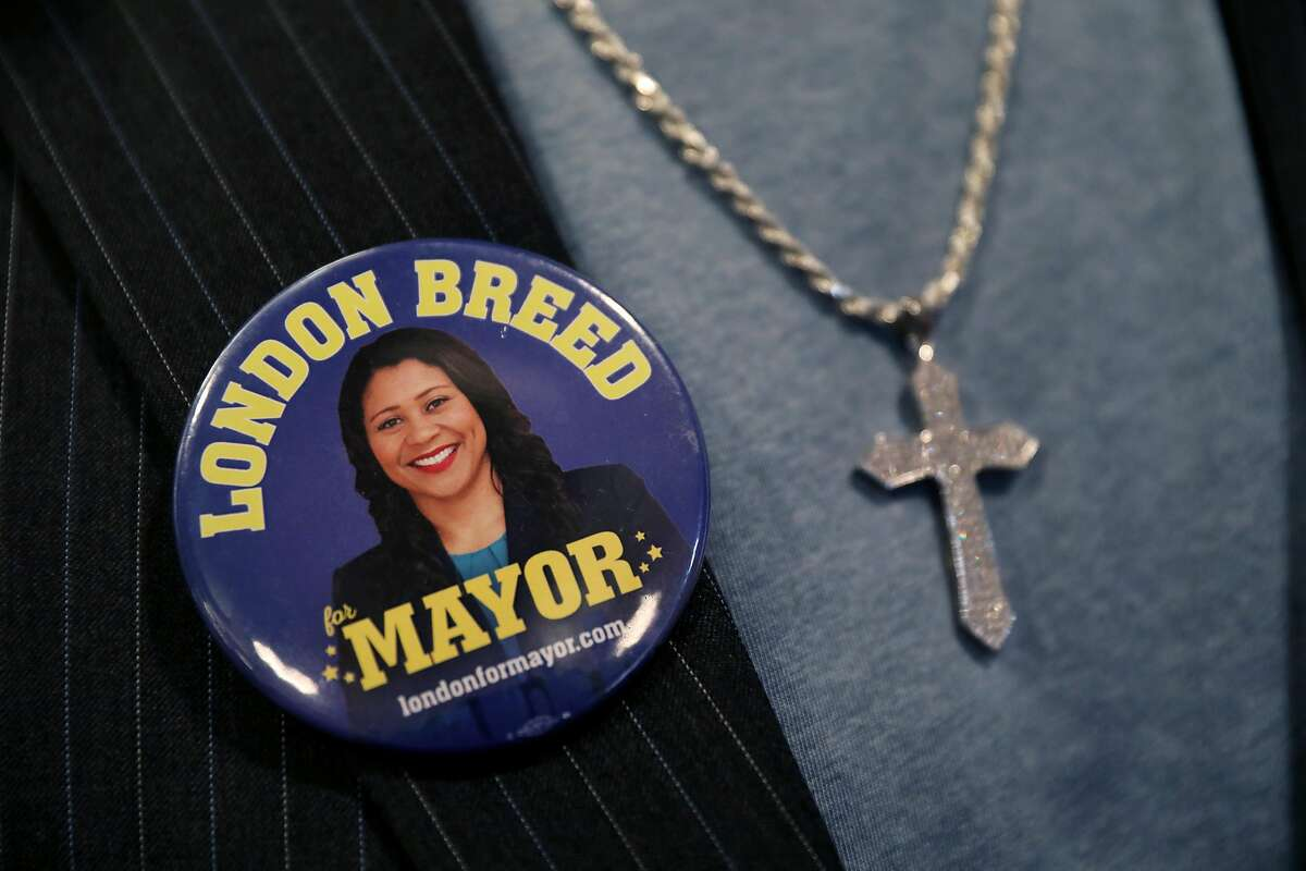 Sam Manneh, a friend of San Francisco Mayor London Breed, wears a button bearing her image after she delivered her State of the City address at the National LGBTQ Center for the Arts in San Francisco, Calif., on Wednesday, January 30, 2019. Manneh said he and Breed served as interns together for former Mayor Willie Brown at the Office of Neighborhood Services.