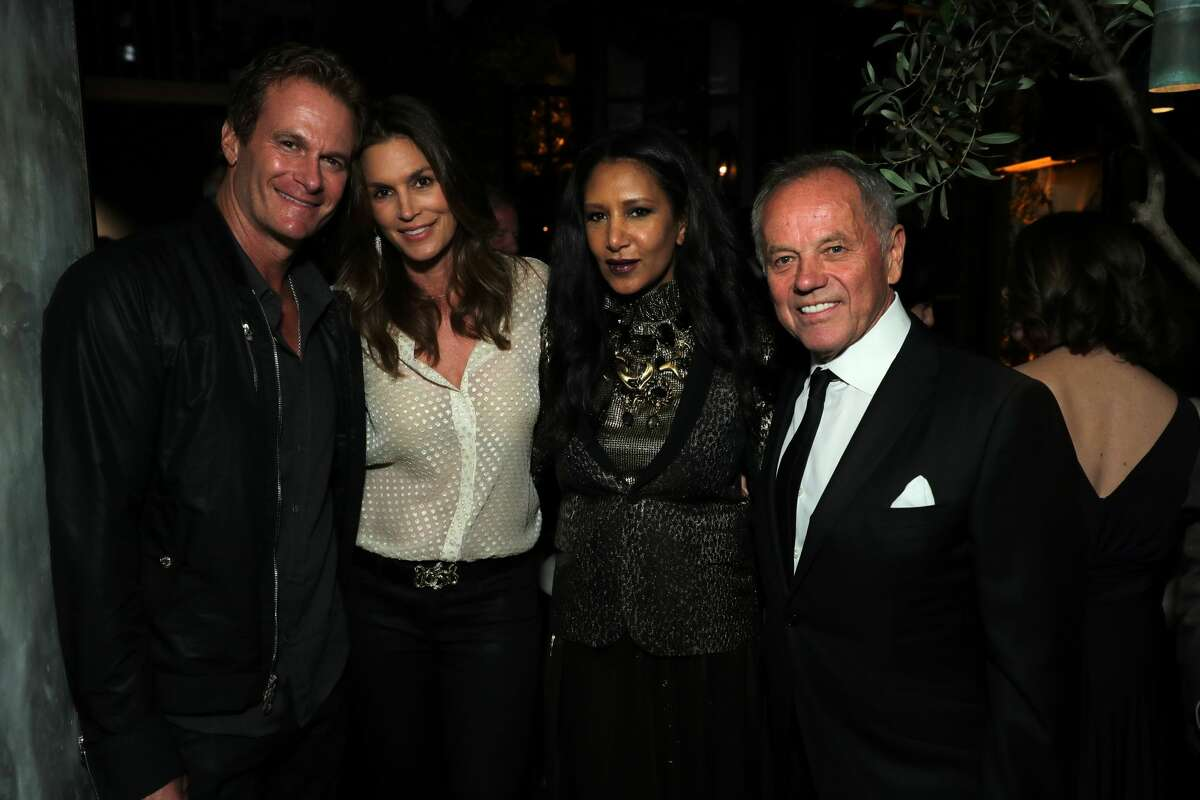BEVERLY HILLS, CA - APRIL 26: Rande Gerber, Cindy Crawford, Gelila Assefa and Wolfgang Puck attend the celebratory party in honor of Wolfgang Puck receiving a star on The Hollywood Walk Of Fame hosted by Gelila Assefa Puck at Spago on April 26, 2017 in Beverly Hills, California. (Photo by Neilson Barnard/Getty Images)