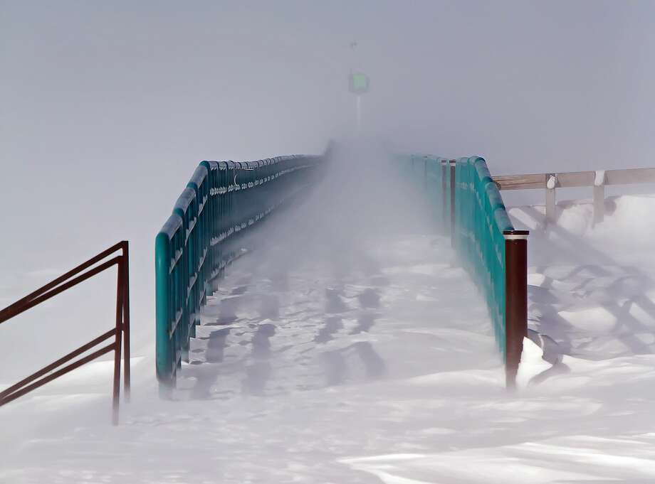 Frigid temperatures and high winds buffeted Pointe Park, in Caseville, this week. High-gusted winds and several inches of powdery snow were the results of these scenes. Photo: Bill Diller/For The Tribune