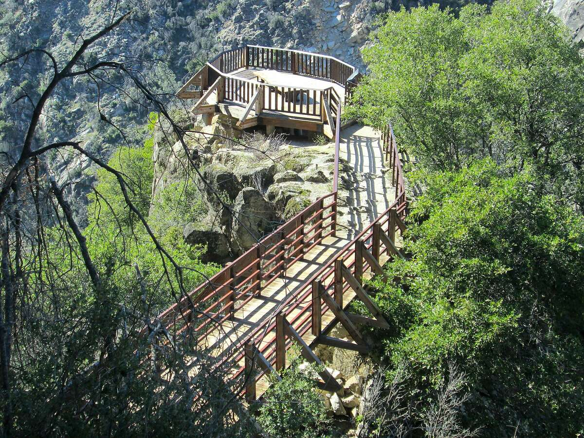 A walkway leads across a knife-edge to a viewing deck perched on an outcrop for one of the best waterfall views in Northern California