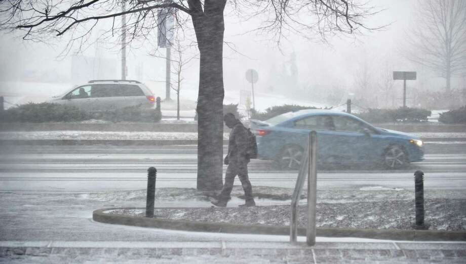 A pedestrian braves the bitter cold as they make there way down Washington Blvd. during a Winter Snow Squall on Wednesday, January 30, 2019 in Stamford, Connecticut. Photo: Matthew Brown / Hearst Connecticut Media / Stamford Advocate