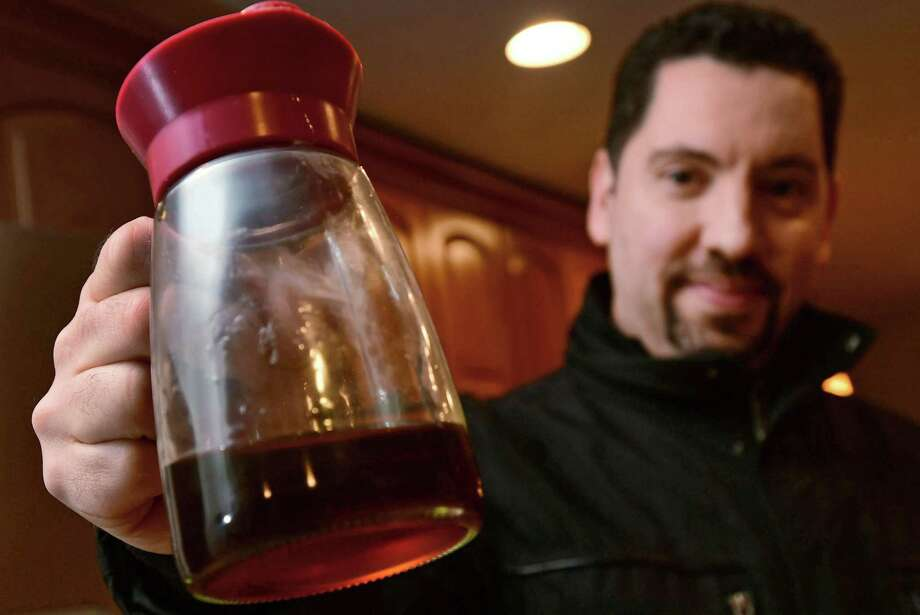 Frank DeMasi taps maple trees in his backyard to make his own syrup with the help of his family Tuesday, January 29, 2019, in Norwalk, Conn. Photo: Erik Trautmann / Hearst Connecticut Media / Norwalk Hour