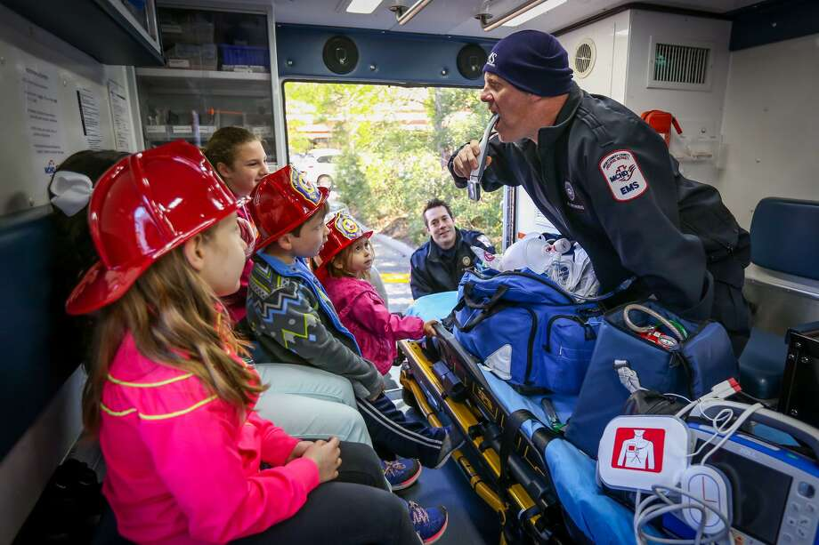 Paramedic Rex Morris, Montgomery County Hospital District, sticks a camera down his throat while demonstrating a few of the many tools available to paramedics in their ambulances during the Safety Day presented by The Woodlands Township Neighborhood Watch on Tuesday, March 14, 2017, in front of The Woodlands Children's Museum. Photo: Michael Minasi, Staff Photographer / Houston Chronicle / © 2017 Houston Chronicle
