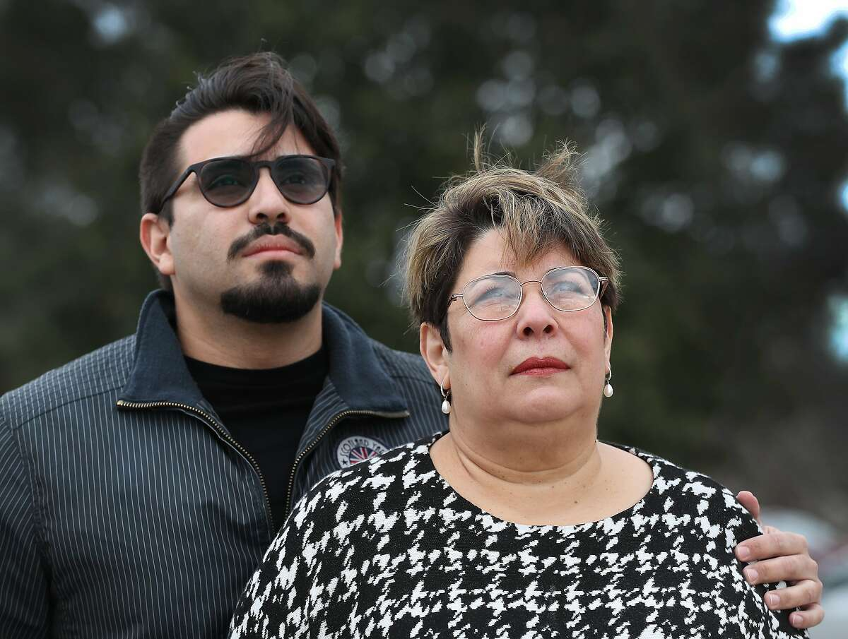 Joao Pereira and his mother, Mervis, are concerned about the head of their family, Jose Pereira, who is being detained on alleged corruption charges while on a business trip to Venezuela Wednesday, Jan. 30, 2019, in Houston.