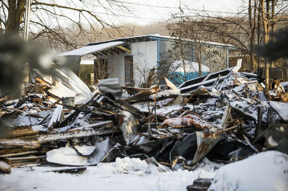 A house neighboring the Gordonville Grocery store located at 1563 S. Meridian Road burned to the ground on Tuesday morning, Jan. 29, 2019. (Katy Kildee/kkildee@mdn.net) Photo: (Katy Kildee/kkildee@mdn.net)