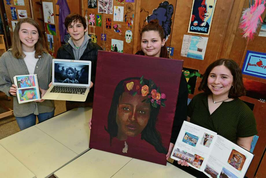Norwalk High School senior art students, Grace Long, Jacob Timchak, Felicity Lagomarsino and Hannah Coleman Tuesday, january 29, 2019, at the school in Norwalk, Conn. The students were selected out of a pool of 2500 entries as winners of a statewide Scholastic Art Award. Their artwork will be hung until Feb. 2 in the University of Hartford Silpe Gallery. Photo: Erik Trautmann / Hearst Connecticut Media / Norwalk Hour