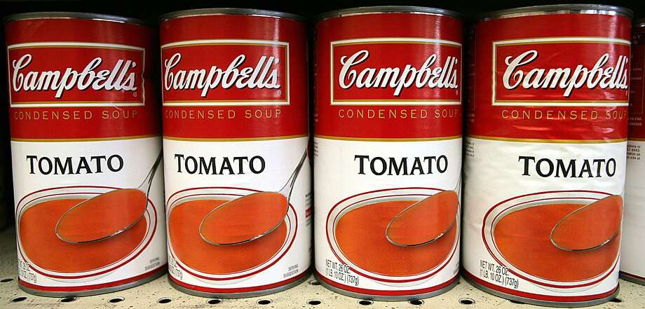 In this file photo, a display of Campbell's Tomato soup cans is seen on the shelves of a Brookshire's grocery store in Tyler, Texas. Stamford-based Silgan Holdings manufactures cans for The Campbell Soup Co. Photo: (AP Photo /Dr. Scott M. Lieberman) / Dr. Scott M. Lieberman