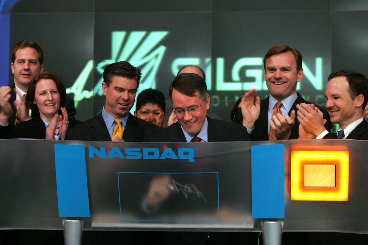 Tony Allott, CEO and chairman of Stamford-based Silgan Holdings, signs his name after ringing the Nasdaq stock exchange's opening bell on Feb. 13, 2007.