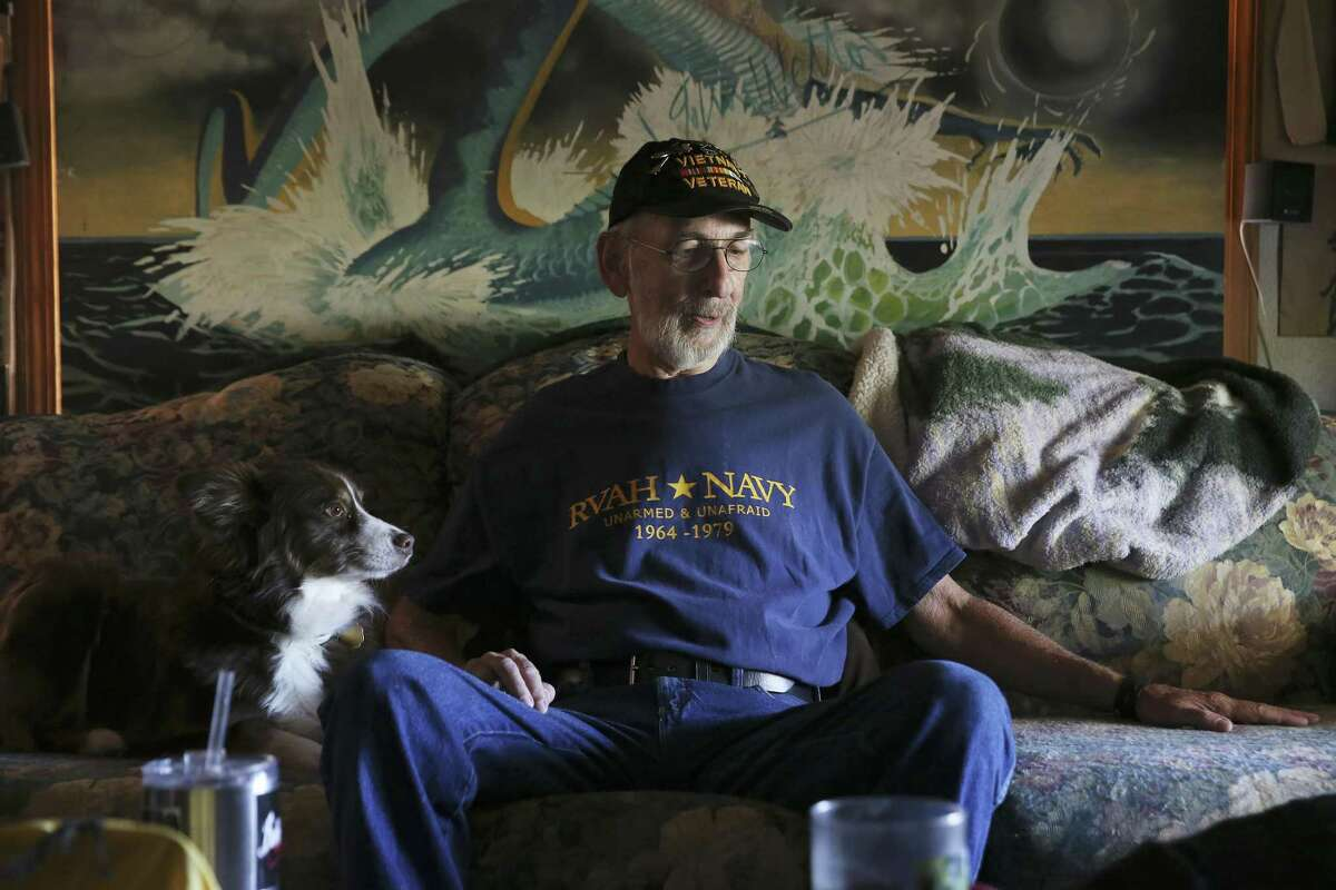 Vietnam veteran Michael Thompson, 67, talks about his Navy experience during an interview at his home near Medina Lake, Thursday, May 31, 2018. Thompson was exposed to Agent Orange while servicing planes on a carrier off the coast of Vietnam. He is fighting the Veterans Administration to recognize Blue Water Navy veterans as victims of Agent Orange exposure. Thompson suffers from several ailments his ascribes to Agent Orange.
