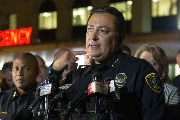 Houston Police Department Chief Art Acevedo updates the media on the conditions of officers injured during a shooting earlier in the evening, at a news conference outside of the emergency department of Memorial Hermann Hospital in the Texas Medical Center, Monday, Jan. 28, 2019, in Houston. Two suspects are dead after a shooting that injured five Houston police officers, including four who were hit by gunfire as they attempted to serve a search warrant at a home where drug selling was suspected, Acevedo said. (Mark Mulligan/Houston Chronicle via AP)