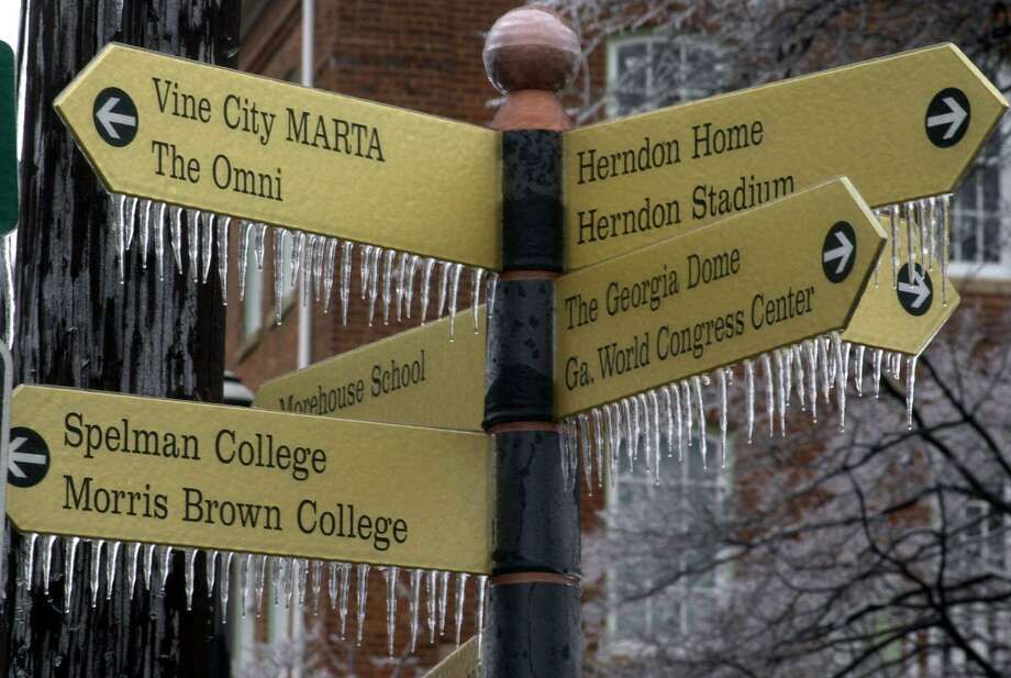 In this Jan. 23, 2000, file photo, ice forms on a street sign on the campus of Morris Brown College following an overnight ice storm in Atlanta. When an ice storm blanketed Atlanta before the city's last Super Bowl in 2000, the fear was the big game would never return. Atlanta Falcons owner Arthur Blank's $1.5 billion Mercedes-Benz Stadium quickly swayed the NFL owners to give Atlanta another chance. Photo: DAVE MARTIN, STF / Associated Press / Copyright 2019 The Associated Press. All rights reserved.