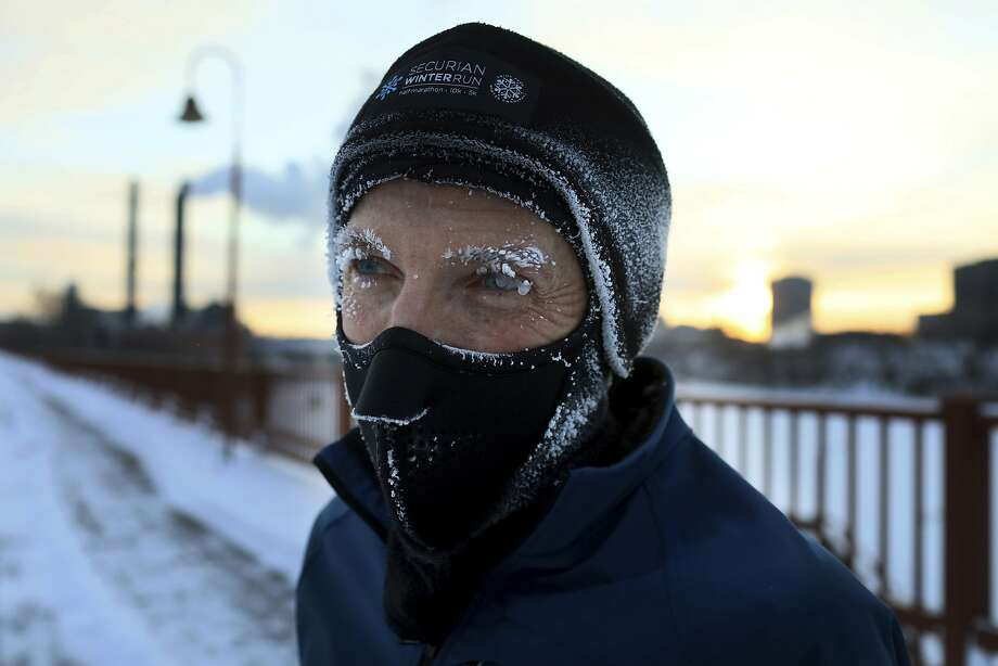 Evan Roberts is covered in frost while jogging across the Stone Arch Bridge Tuesday, Jan. 29, 2019, In Minneapolis.  Extreme cold and record-breaking temperatures are crawling into parts of the Midwest after a powerful snowstorm pounded the region, and forecasters warn that the frigid weather could be life-threatening.  Roberts, who is originally from New Zealand, said he will take tomorrow off from running outside and run inside on a treadmill.   (David Joles/Star Tribune via AP) Photo: David Joles, Associated Press