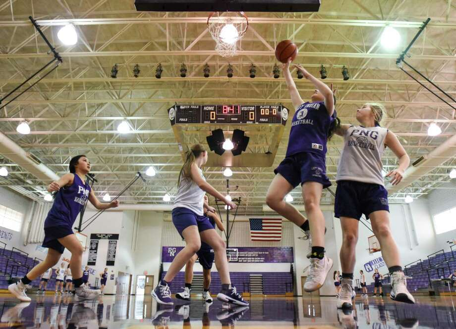 Port Neches-Grooves girls basketball team practices in their gym on Wednesday.