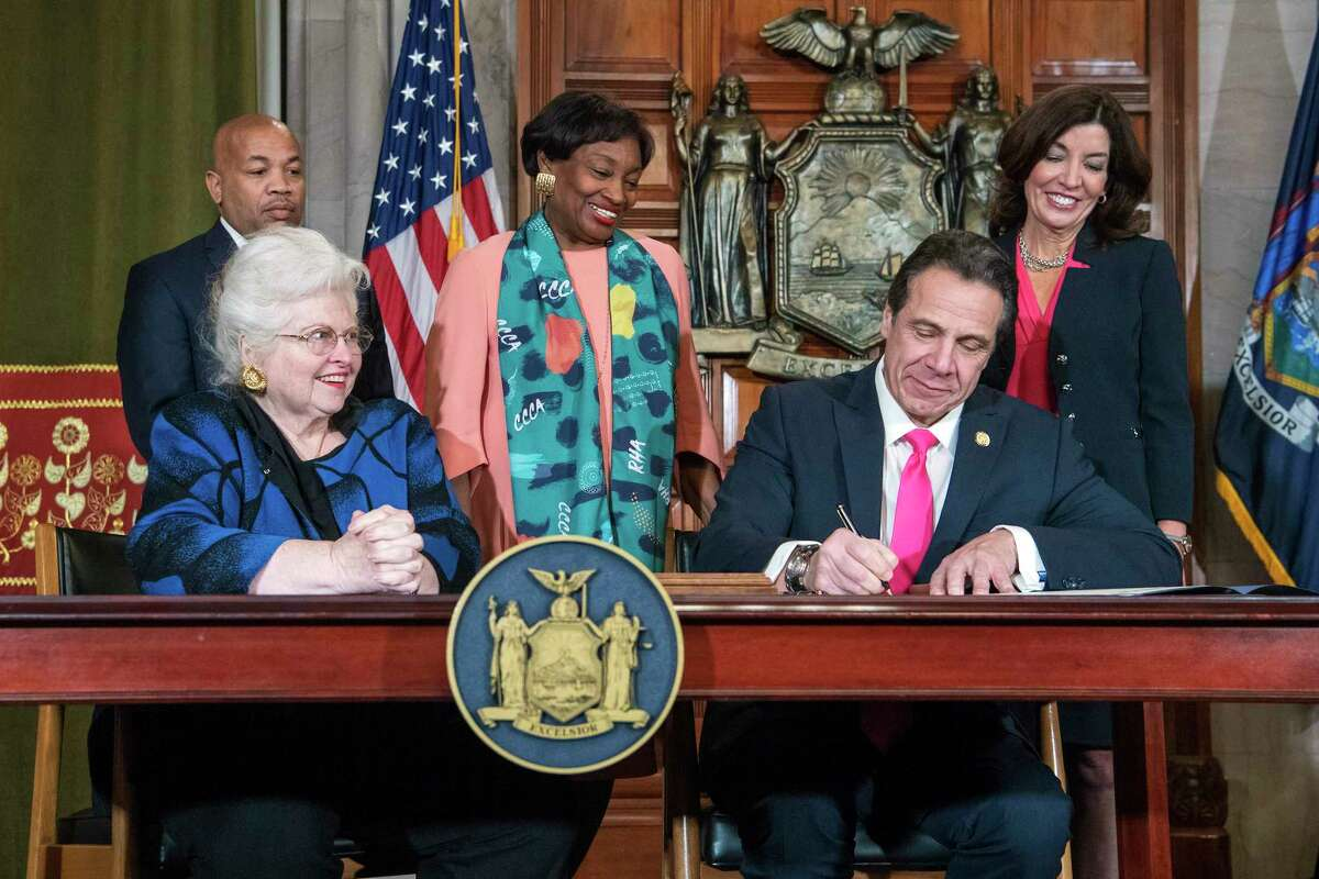 In this photo provided by the Office of Gov. Andrew M. Cuomo, Cuomo, right, signs Reproductive Health Act Legislation during a ceremony, Tuesday, Jan. 22, 2019, in the Red Room at the State Capitol in Albany, N.Y. With the new law, New York state enacts one of the nation's strongest protections for abortion rights, a move that state leaders say was needed to safeguard those rights should the U.S. Supreme Court overturn Roe v. Wade. (Darren McGee/Office of Gov. Andrew M. Cuomo via AP)