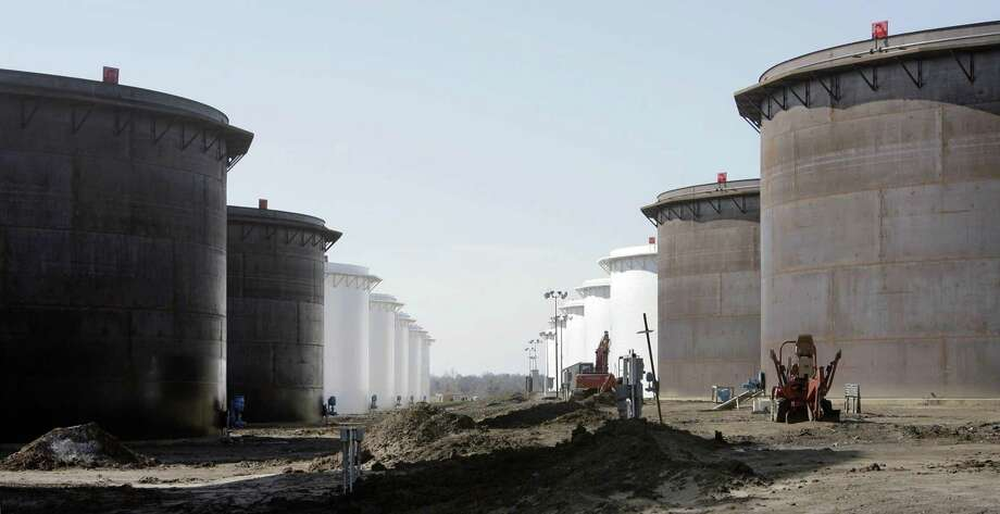 This March 13, 2012 photo shows older and newly constructed 250,000 barrel capacity oil storage tanks at the SemCrude tank farm north of Cushing, Okla. Photo: Michael Wyke, MBI / Associated Press / Tulsa World