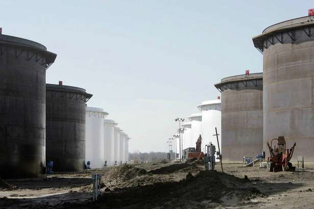 This March 13, 2012 photo shows older and newly constructed 250,000 barrel capacity oil storage tanks at the SemCrude tank farm north of Cushing, Okla. For the past seven weeks, the United States has been producing and importing an average of 1 million more barrels of oil every day than it is consuming. That extra crude is flowing into storage tanks, especially at the country's main trading hub in Cushing, pushing U.S. supplies to their highest point in at least 80 years, the Energy Department reported Wednesday, Feb. 25, 2015. (AP Photo/Tulsa World, Michael Wyke) KOTV OUT; KJRH OUT; KTUL OUT; KOKI OUT; KQCW OUT; KDOR OUT; TULSA OUT; TULSA ONLINE OUT