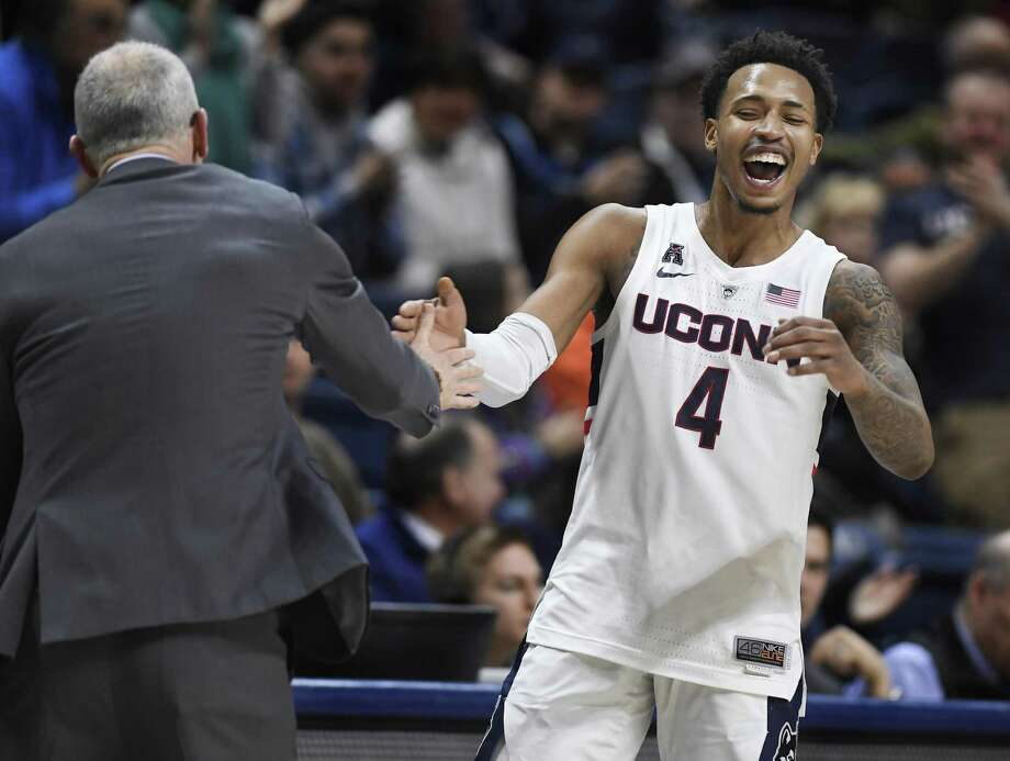 UConn's Jalen Adams (4) celebrates with head coach Dan Hurley against Tulane on Jan. 19 in Storrs. Adams will be honored as part of Senior Night festivities on Thursday night. Photo: Jessica Hill / Associated Press / Copyright 2019 The Associated Press. All rights reserved
