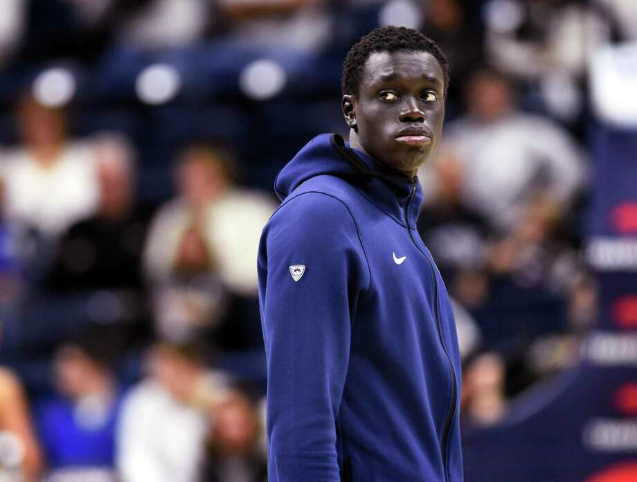 UConn's Akok Akok has gotten some help in his transition to college life from teammate Mamadou Diarra. Photo: Stephen Dunn / Associated Press / Copyright 2019 The Associated Press. All rights reserved